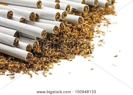Cigarettes  On A Heap Of Loose Tobacco, Corner Background On White
