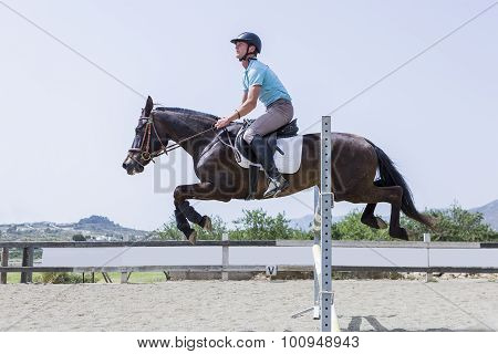 Boy Jumping With Horse.