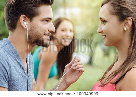 Friends Sharing Earphones