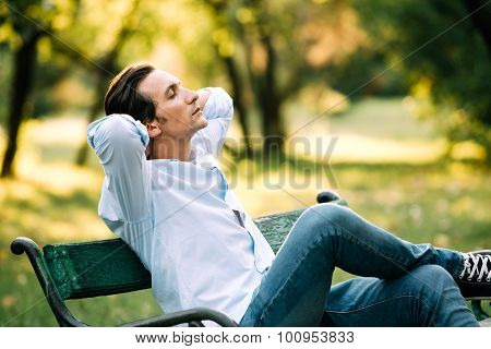 Handsome Adult Man Sitting On Bench