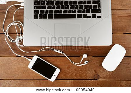 Computer peripherals and laptop accessories on wooden background
