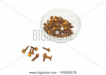 Clove In Small Glass Container And Several Cloves Separately