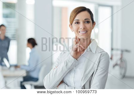 Confident Woman Entrepreneur Posing In Her Office