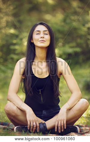 beautiful young woman meditating in yoga position