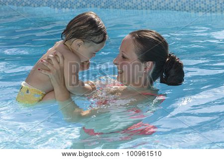 Mother enjoying a pool with child