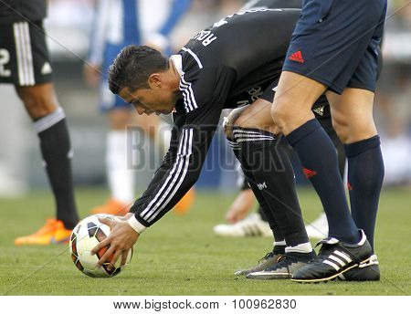 BARCELONA - MAY, 2015: Cristiano Ronaldo of Real Madrid preparing to launch kick off  during a Spanish League match against RCD Espanyol at the Power8 stadium on Maig 17 2015 in Barcelona Spain