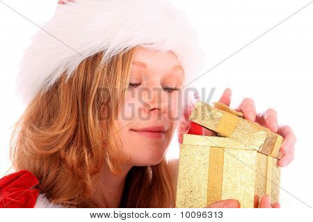 Miss Santa Is Sneaking A Peek At A Golden Gift Box