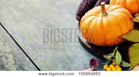 Autumn concept with seasonal fruits and vegetables on wooden board