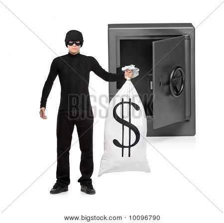 Full Length Portrait Of A Thief Stealing A Money Bag From A Safe
