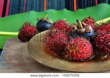 Mangosteen And Rambutan On Golden Plate