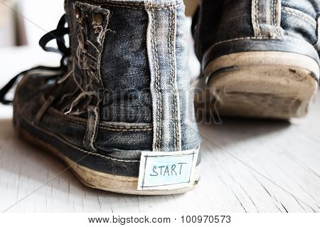 Label With The Word Start On Sneakers.
