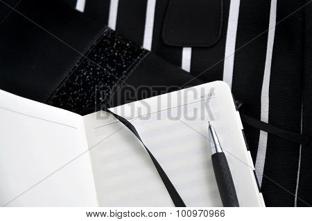 Pen On Notebook With Black Background
