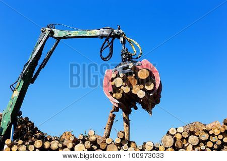 A Log Loader Or Forestry Machine
