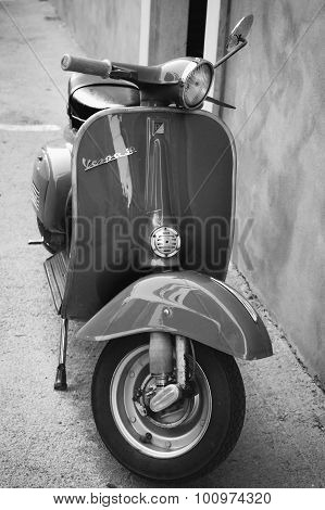 Classic Vespa Scooter Parked Near Wall