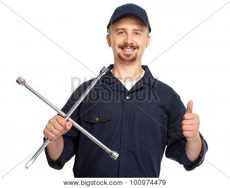 Smiling car mechanic with a wrench isolated white background.