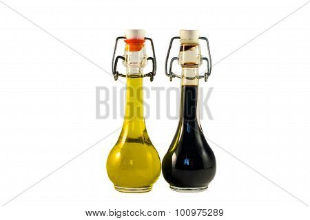 Two bottles of wine vinegar and olive oil