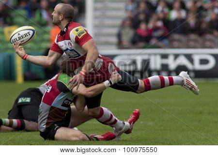 TWICKENHAM, ENGLAND. 17 SEPTEMBER 2011.  Gloucester's Charlie Sharples,  paases the ball as he is tackled during the Aviva premiership rugby union match between Harlequins and Gloucester