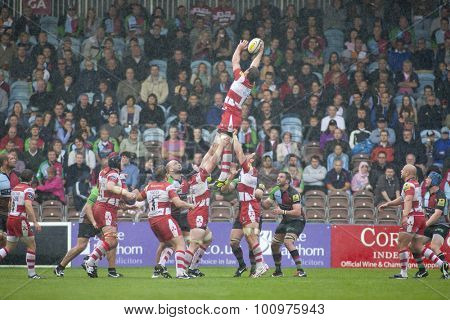 TWICKENHAM, ENGLAND. 17 SEPTEMBER 2011.  Gloucester's Brett Deacon, catches the ball during a heavy rain shower, at a lineout during the premiership rugby union match between Harlequins and Gloucester