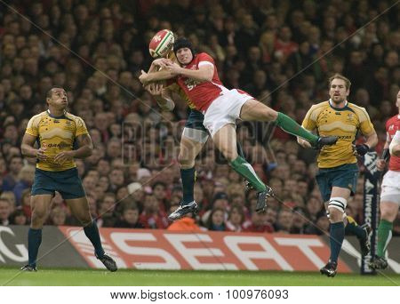CARDIFF, WALES. 28 NOVEMBER 2009. Leigh Halfpenny of Wales drops the ball in mid air  while playing in the Invesco Perpetual International Rugby Union match between Wales and Australia