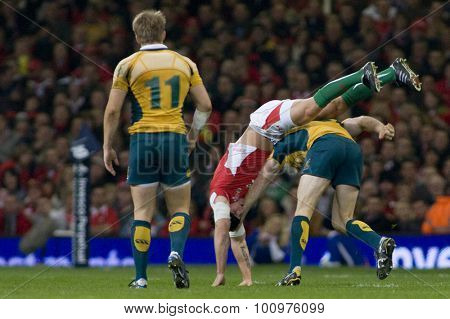 CARDIFF, WALES. 28 NOVEMBER 2009. Tom James of Wales and David Pocock playing for Australia tussle  while playing in the International Rugby Union match between Wales and Australia