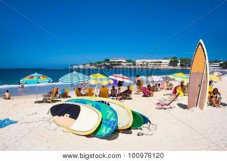 RIO DE JANEIRO, BRAZIL - APRIL 24, 2015: Surfboard and Brazilians on April 24, 2015 at Copacabana Beach, Rio de Janeiro. Brazil.