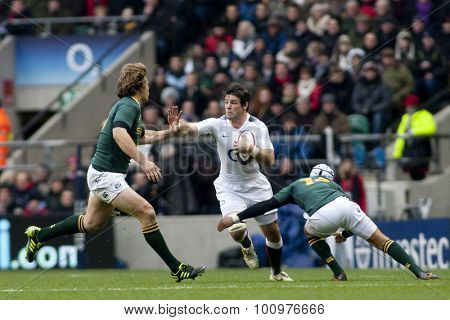 TWICKENHAM LONDON, 27 NOVEMBER 2010. England's Ben Foden, is tackled by South Africa's Jannie du Plessis, and South Africa's Gio Aplon, during the  International match between England and South Africa