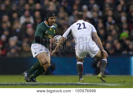 TWICKENHAM LONDON, 27 NOVEMBER 2010.  South Africa's Adi Jacobs. runs at England's Charlie Hodgson, during the International match between England and South Africa at Twickenham Stadium Middlesex