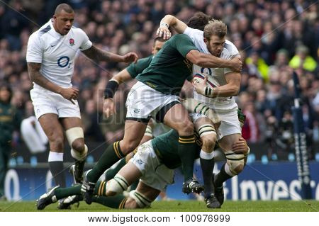 TWICKENHAM LONDON, 27 NOVEMBER 2010. England's Tom Croft, is tackled by 2 South African players  during the  International match between England and South Africa at Twickenham Stadium Middlesex