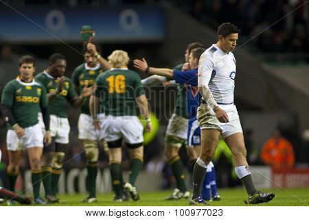 TWICKENHAM LONDON, 27 NOVEMBER 2010. England's Shontayne Hape, as South African players celebrate the victory in the International match between England and South Africa