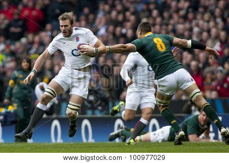 TWICKENHAM LONDON, 27 NOVEMBER 2010.  England's Tom Croft evades the tackle of South Africa's Pierre Spies, during the Investec International match between England and South Africa