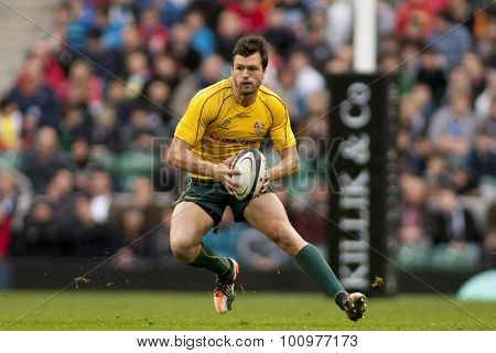 LONDON, ENGLAND. 26 NOVEMBER 2011. Australia's Adam Ashley-Cooper, in action during the Killik Cup, rugby union match between the Barbarians and Australia, played at Twickenham Stadium.