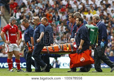 LONDON, ENGLAND. 06 AUGUST 2011. Morgan Stoddart playing for Wales is carried off with a suspected broken leg during the rugby union International between England and Wales at Twickenham Stadium