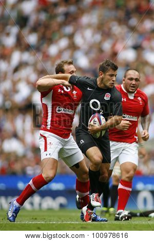 LONDON, ENGLAND. 06 AUGUST 2011. Danny Care playing for England, shrugs off a challenge from Rhys Priestland, playing for Wales  during the rugby union International between England and Wales