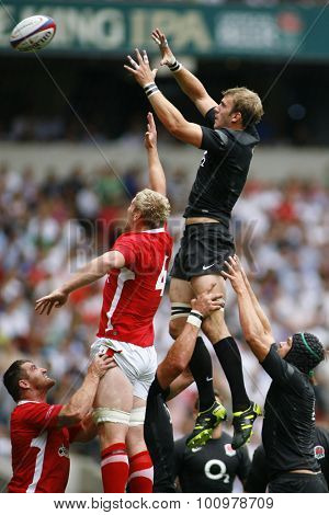 LONDON, ENGLAND. 06 AUGUST 2011. Tom Croft playing for England, and Bradley Davies, playing for Wales compete in the air at a lineout during the rugby union International between England and Wales