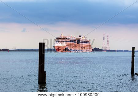 Stade, Germany - September 3, 2015: Cruise ship AIDAdiva passing Stade on the Elbe river. The ship is owned and operated by Carnival Corporation.