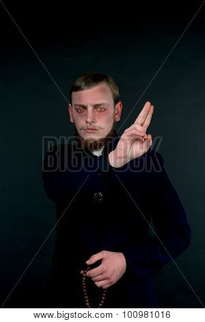 Halloween. A Man Dressed As The Evil Catholic Priest