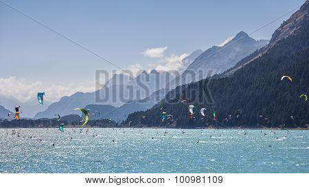 Kitesurfing And Windsurfing In A Mountain Lake
