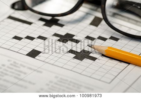 Crossword puzzle,pencil and reading glasses