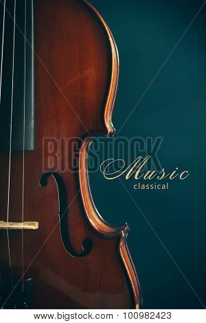 Classical violin on dark blue background