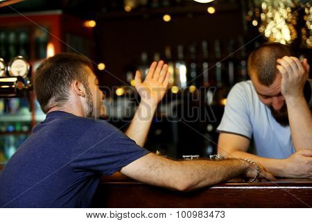 Young drunk man in bar