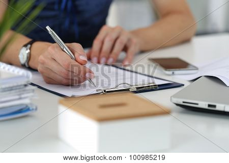 Close-up Of Female Hands Working At Office