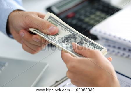 Man Taking Batch Of Hundred Dollar Bills