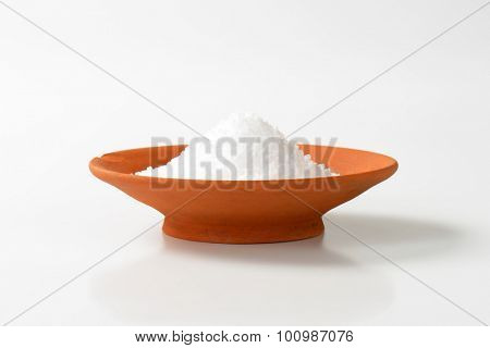 Coarse grained salt in terracotta bowl