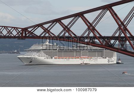 FORTH RAIL BRIDGE, SCOTLAND - SEPTEMBER 5: Cruise ship MSC Splendida with Forth Rail Bridge on September 5, 2015 in Forth Rail Bridge near Edinburgh, Scotland