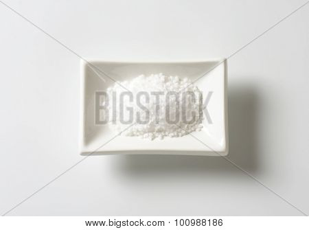 coarse ground salt in white rectangular bowl