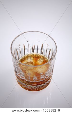 wine glass with liquor on the white background