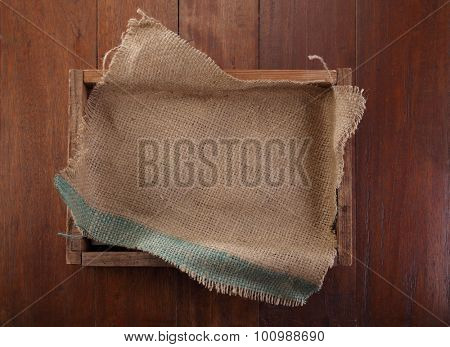 sack cloth on top of wooden crate