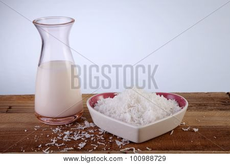 jar of coconut milk and shredded coconut