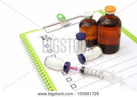 Medical Ampules, Bottleand Syringes On Medical Plan , Isolated On White