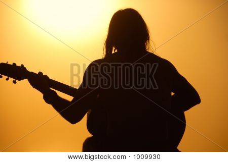 Guitar Man: Silhouette Sunset